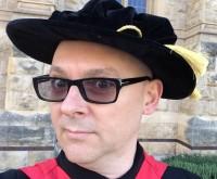 Doctor D-mat Dons A Hat